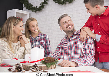 Family in christmas dining room