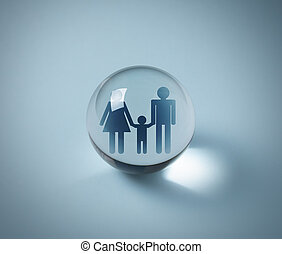 Family in crystal ball, family person insurance concept