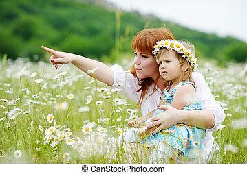 family in daisy field