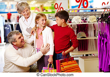 Family in department store - Portrait of happy grandparents...