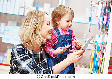 family in drug store. Mother and child