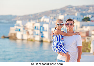 Family in Europe. Father and little girl background Little Venice in Mykonos, Greece