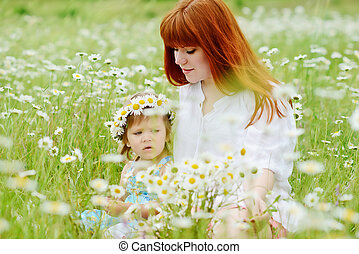 family in filed - family in the filed of  daisies