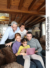 Family in front of a computer