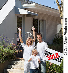 Family in front of House for sale - Family in front of House...