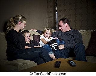 Family in front of the TV