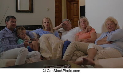 Family in front of TV at home