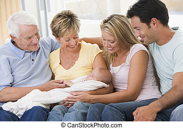 Family in living room with baby smiling