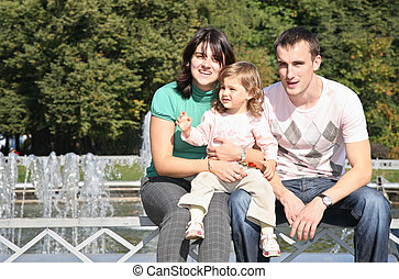 Family in park at fontain