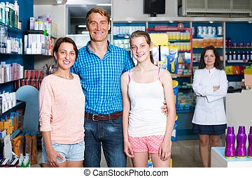 family in pharmaceutical store .