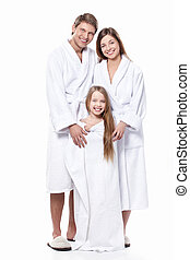 Family in robes - Young family in robes on a white...