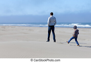 family in sand dunes