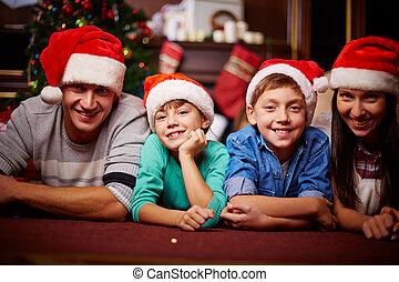 Family in Santa caps - Christmas family in Santa caps ...