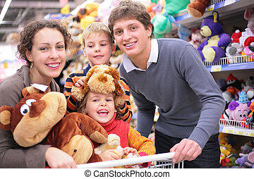 Family in shop with soft toys - Family of four in shop with...