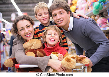 Family in shop with toys