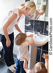 Family in the bathroom