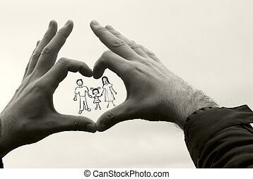 family in the hands of men against the sky