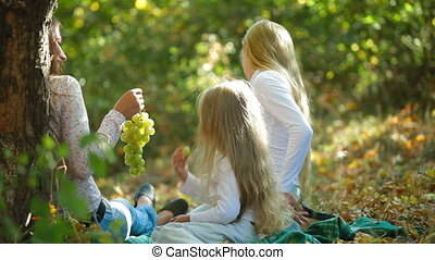 Mother and two daughters spending time together in the park