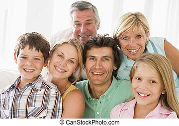 Family indoors together smiling