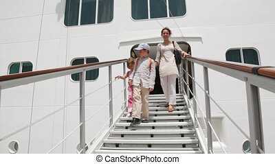 family is going down from trap of ship - family of three...