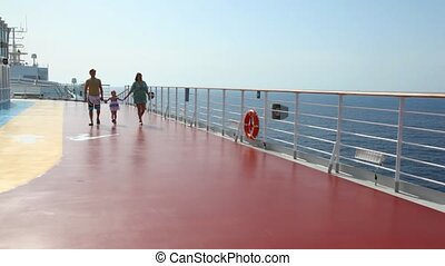 family is going to camera on deck of ship