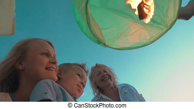 Family is going to fly sky lantern