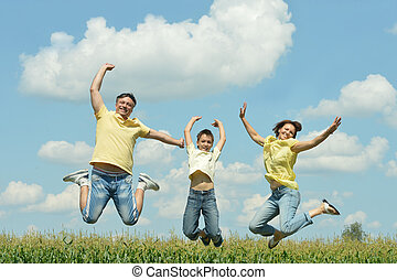 Family jumping on field