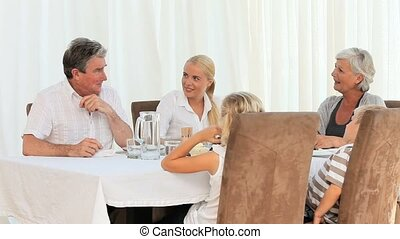 Family laughing during dinner