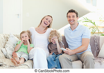 Family laughing on the sofa