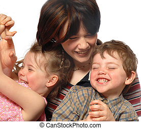 Family laughing - mother, daughter and son