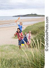 Family leaving the beach
