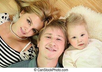 family lie on floor