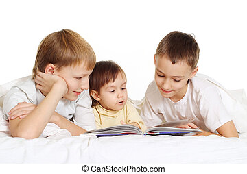 family lie on the floor and reading a book