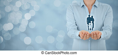 Family life insurance, family services and supporting families concepts. Businesswoman with protective gesture and silhouette representing young family. Wide banner composition and bokeh in background.