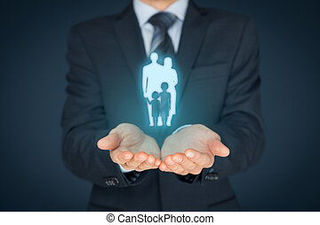 Family life insurance, family services and supporting families concepts. Businessman with protective gesture and silhouette representing young family.