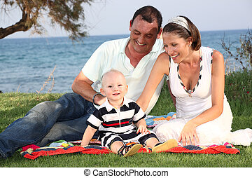 family lifestyle portrait of a mum and dad with their baby...