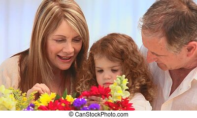 Family looking at a bunch of flowers