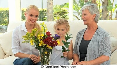 Family looking at a flower bouquet