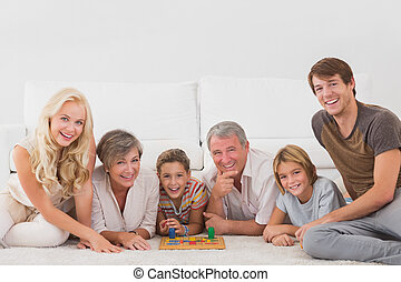 Family looking at the camera with board games