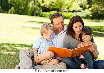 Family looking at their photo album