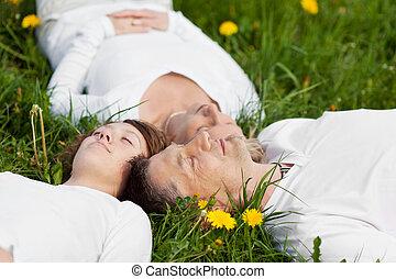 family lying head to head