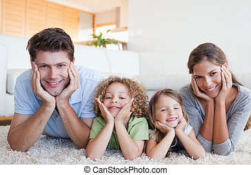 Family lying on a carpet