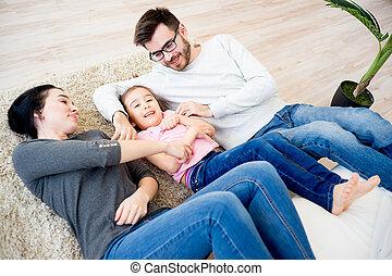 Family lying on floor