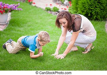 Family Lying On Grass In Park