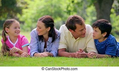 Family lying while chatting together