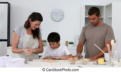 Family making a dough together