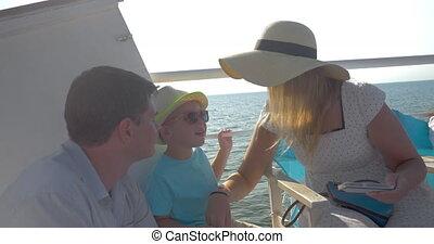 Family making mobile selfie on the ship