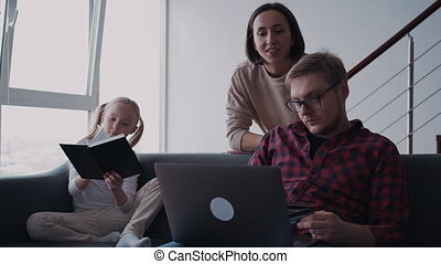 Family making online shopping together, using laptop and two pla
