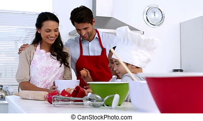 Family making pastry together in kitchen at home