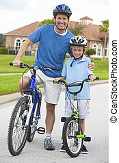 Family Man and Boy Child, Father & Son Cycling